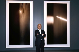 Artist Hiroshi Shugimoto front of his works - Boucheron Hosts Hiroshi Shugimoto Exhibition Celebration at Place Vendome