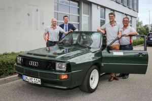 Vorfreude auf die DONAU CLASSIC 2016 (vo. li.): Alexander Arold (DONAU CLASSIC), Timo Witt (Audi Tradition), Robert Faber (DONAU CLASSIC), Peter Hallauer (DONAU CLASSIC) und der grüne Audi Sport quattro mit dem Walter Röhrl und Christian Geistdörfer bei der diesjährigen DONAU CLASSIC als Vorausfahrzeug unterwegs sind.